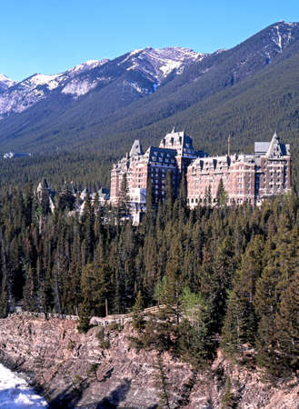 View across the river towards the Banff Springs Hotel during the Springtime Banff National Park Alberta Canada.
