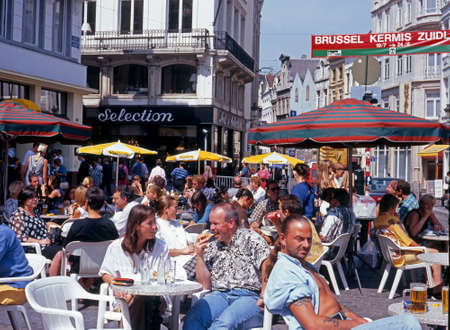 rue: Tourists relaxing at pavement cafes on the Rue de Marche Brussels Belgium Western Europe. Editorial