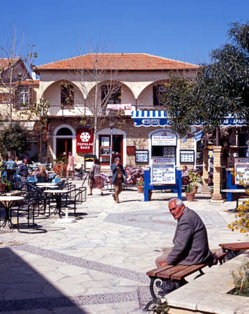 polis: People relaxing in the restaurant area of the old town Polis Cyprus.