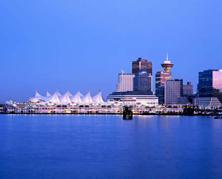 Canada Place and Vancouver trading convention centre across the harbour at night Vancouver British Columbia Canada.