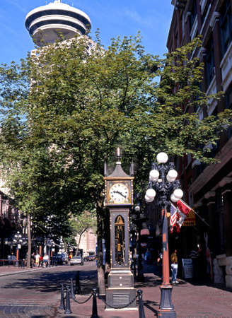 british weather: Gas Town steam clock and ornate streetlight Vancouver British Columbia Canada.