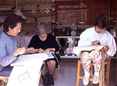 cypriot: Three Cypriot women lace making in a shop doorway Kato Lefkara Cyprus.