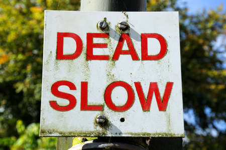 tatty: Dead slow traffic sign on a lamppost Stock Photo