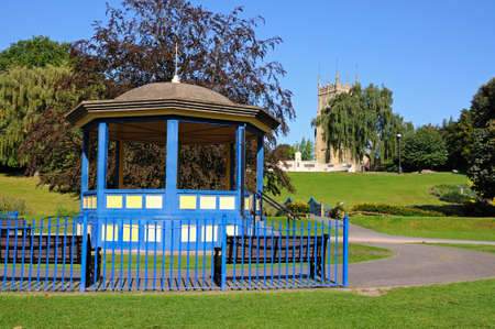 worcestershire: Bandstand in Abbey Gardens with the Abbey clock tower to the rear Evesham Worcestershire England UK Western Europe. Stock Photo