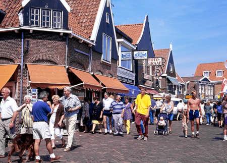 volendam: Tourists walking along a shopping street during the Summertime, Volendam, Holland, Netherlands, Europe.