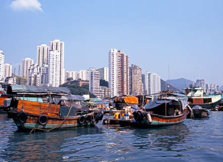 high rise buildings: Sampans in the harbour with high rise buildings to the rear, Aberdeen, Hong Kong, China Editorial