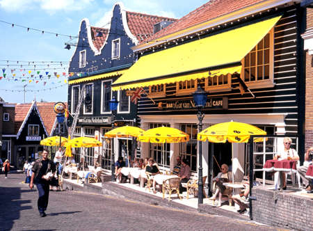volendam: People relaxing at pavement cafes during the Summertime, Volendam, Holland, Netherlands, Europe.