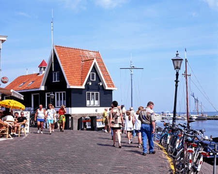 quayside: Tourists walking along the quayside street, Volendam, Holland, Netherlands, Europe. Editorial
