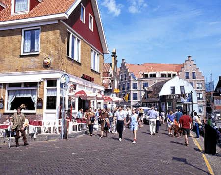 volendam: Tourists walking along a shopping street in the port area, Volendam, Holland, Netherlands, Europe. Editorial