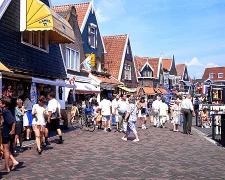volendam: Tourists walking along the quayside shopping street during the Summertime, Volendam, Holland, Netherlands, Europe.