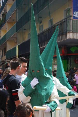 semana: Members of the Pollinca brotherhoo walking through the city centre dripping candle wax onto wax balls during Santa Semana, Malaga, Malaga Province, Andalusia, Spain, Western Europe. Editorial