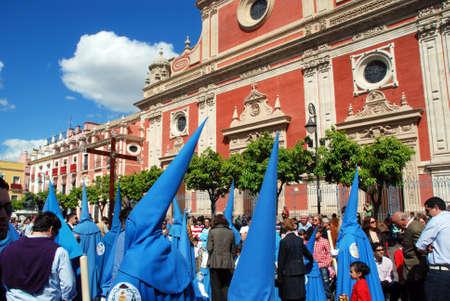 brotherhood: Members of the San Esteban brotherhood walking through the city streets during Santa Semama, Seville, Seville Province, Andalusia, Spain, Western Europe.
