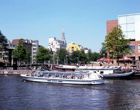 amstel: Tourist boat trip along the River Amstel, Amsterdam, Holland, Netherlands, Europe.
