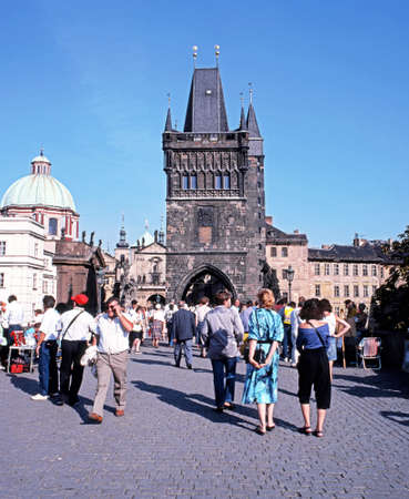central europe: Tourists walking across Charles Bridge towards the Old Town Bridge Tower, Prague, Czech Republic, Central Europe. Editorial