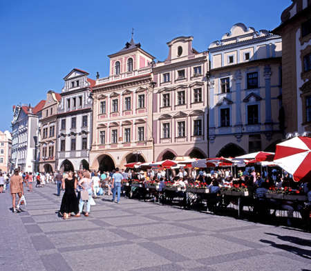 town square: Tourists and pavement cafes in the Old Town Square, Prague, Czech Republic, Central Europe. Editorial