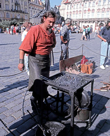 central europe: Blacksmith working in the Old Square, Prague, Czech Republic, Central Europe. Editorial