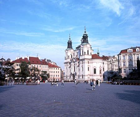 central europe: View across the Old Square towards St Nicholas Church, Prague, Czech Republic, Central Europe.