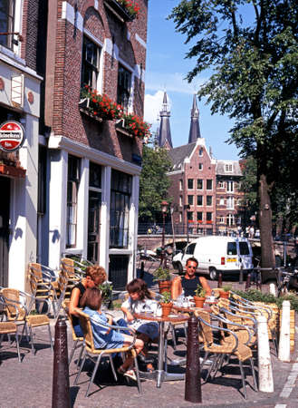 prinsengracht: People relaxing at a pavement cafe along Prinsengracht, Amsterdam, Holland, Netherlands, Europe.