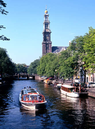 prinsengracht: Boats on the Prinsengracht with the Westerkerk to rear, Amsterdam, Holland, Netherlands, Europe. Editorial