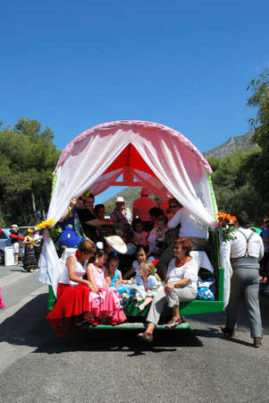 people travelling: Spanish people travelling in a caravan during the Romeria San Bernabe procession, Marbella, Costa del Sol, Malaga Province, Andalusia, Spain, Western Europe. Editorial
