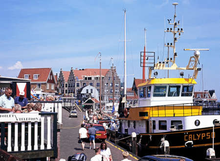 volendam: Tourists walking along the quayside shopping street during the Summertime, Volendam, Holland, Netherlands, Europe.