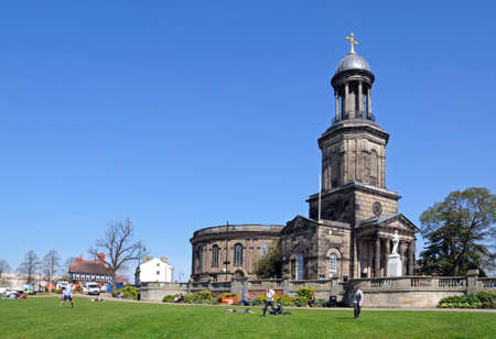 View of St Chads church with people sitting on the grass in the park in the foreground, Shrewsbury, Shropshire, England, UK, Western Europe.
