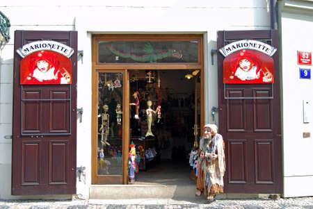 mementos: Souvenir puppets (Marionettes) for sale in a city centre shop, Czech Republic, Eastern Europe.