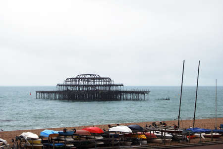 west sussex: Remains of West Pier which was closed in 1975 and subsequently damaged by fire and storms with part of the structure being removed in 2010, Brighton, West Sussex, England, UK, Western Europe.