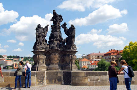 st charles: Statue of The Madonna, St Dominic and St Thomas along the North side of Charles Bridge (Karluv Most), Prague, Czech Republic, Eastern Europe.