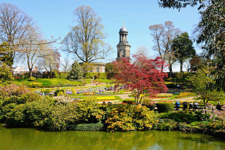 View of The Dingle formal garden in Quarry Park during the Springtime with St Chads church to the rear, Shrewsbury, Shropshire, England, UK, Western Europe. Editorial