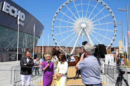 horse show: TV presenter interviewing the Showjumper Peter Charles Olympic Gold Medallist 2012 to promote the launch of the Liverpool International Horse Show 2016, Liverpool, Merseyside, England, UK, Western Europe.
