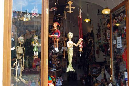 mementos: Souvenir puppets (Marionettes) for sale incity centre shop, Czech Republic, Eastern Europe.