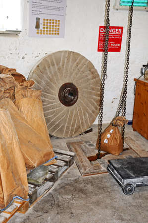 hoist: Sack hoist chain and sacks of flour inside Greens windmill, Nottingham, Nottinghamshire, England, UK, Western Europe. Editorial