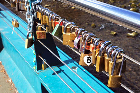 derbyshire: Love locks attached to the cable bridge, Bakewell, Derbyshire, England, UK, Western Europe.