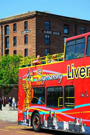 tour bus: Red tour bus outside Albert Dock, Liverpool, Merseyside, England, UK, Western Europe.