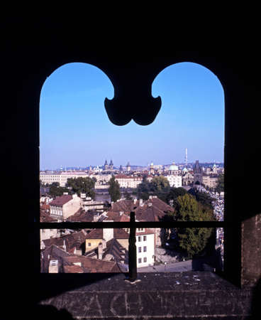central europe: City rooftops seen through a shaped stone window, Prague, Czech Republic, Central Europe.