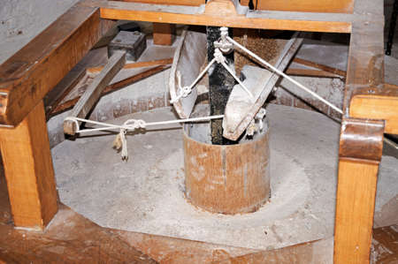 flour mill: Grinding wheel mechanism inside a flour mill windmill, Nottingham, Nottinghamshire, England, UK, Western Europe. Stock Photo