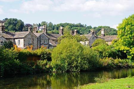 derbyshire: Cottages alongside the River Wye, Bakewell, Derbyshire, England, UK, Western Europe.