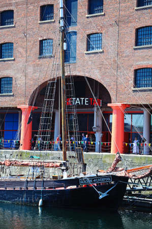 merseyside: Albert dock opened in 1846 with a ship in the foreground and the entrance to Tate Liverpool Art Gallery to the rear, Liverpool, Merseyside, England, UK, Western Europe. Editorial
