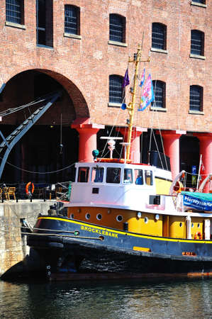 tug boat: Tug boat moored in Albert Dock, Liverpool, Merseyside, England, UK, Western Europe.