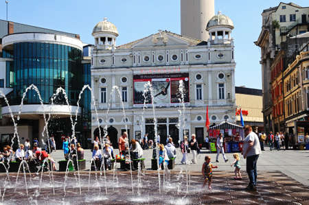 playhouse: The Playhouse Theatre in Williamson Square with fountains in the foreground and people enjoying the Summer sunshine, Liverpool, Merseyside, England, UK, Western Europe. Editorial