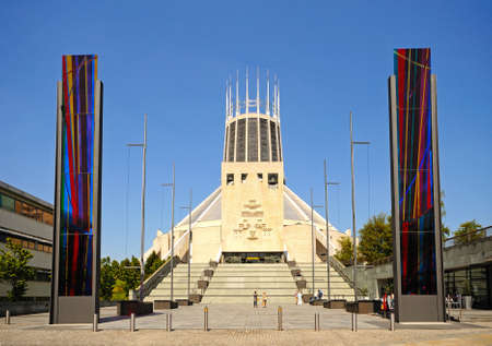 Front view of the Roman Catholic Cathedral with stained glass panels at the base of the steps in the foreground, Liverpool, Merseyside, England, UK, Western Europe. Editorial