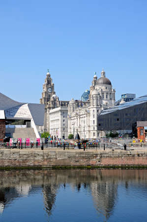 canning: The Three Graces seen across Canning Dock, Liverpool, Merseyside, England, UK, Western Europe. Editorial