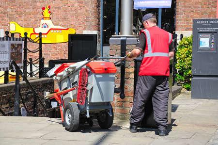 britannia: Litter picker outside the Britannia Pavilion at Albert Dock, Liverpool, Merseyside, England, UK, Western Europe. Editorial