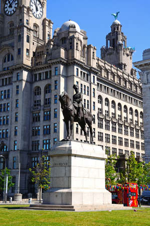 king edward: Statue of King Edward VII with the Liver Building to the rear at Pier Head, Liverpool, Merseyside, England, UK, Western Europe.