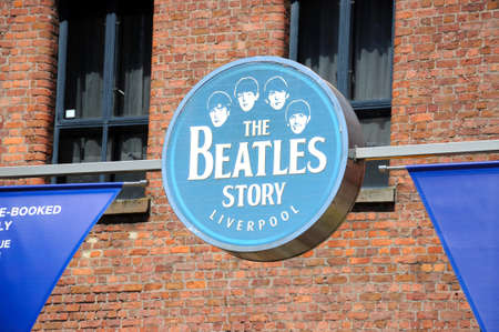 the beatles: Sign on the outside of The Beatles Story building at Albert Dock, Liverpool, Merseyside, England, UK, Western Europe.
