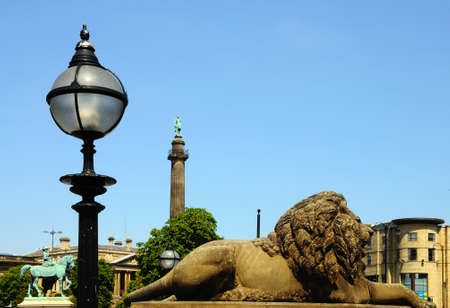 wellingtons: Lion statue outside St Georges Hall with Wellingtons Column to the rear, Liverpool, Merseyside, England, UK, Western Europe.