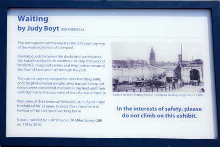 dockside: Waiting statue by Judy Boyt information sign in Canning Dock, Liverpool, Merseyside, England, UK, Western Europe.
