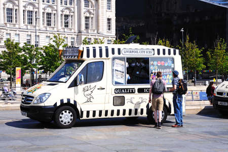 merseyside: People buying ice cream from an ice cream van by the quayside, Liverpool, Merseyside, England, UK, Western Europe. Editorial