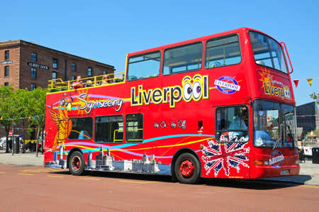 open topped: Red tour bus outside Albert Dock, Liverpool, Merseyside, England, UK, Western Europe.